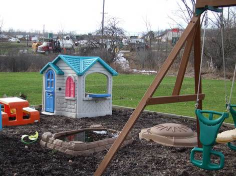 swing set with fracking waste spill