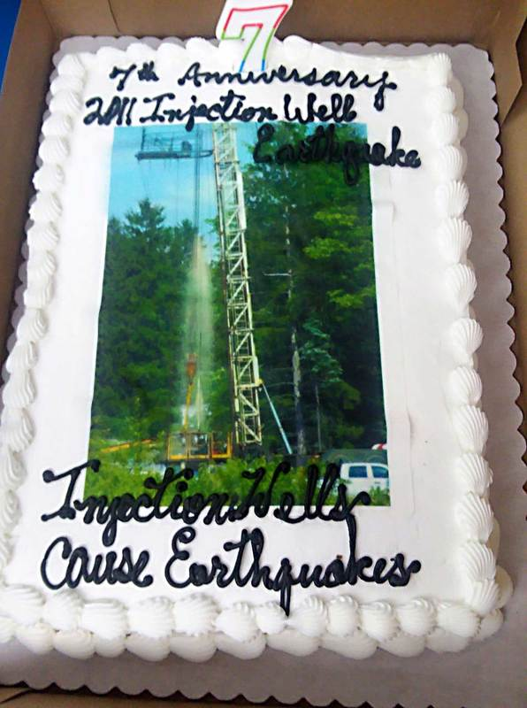 cake with image of unkown fluid spewing out of injection well being plugged back Coitsville Ohio