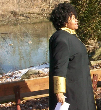 Reverend Monica Beasley-Martin delivering sermon on the banks of the Mahoning, Youngstown, Ohio, February 10, 2013.